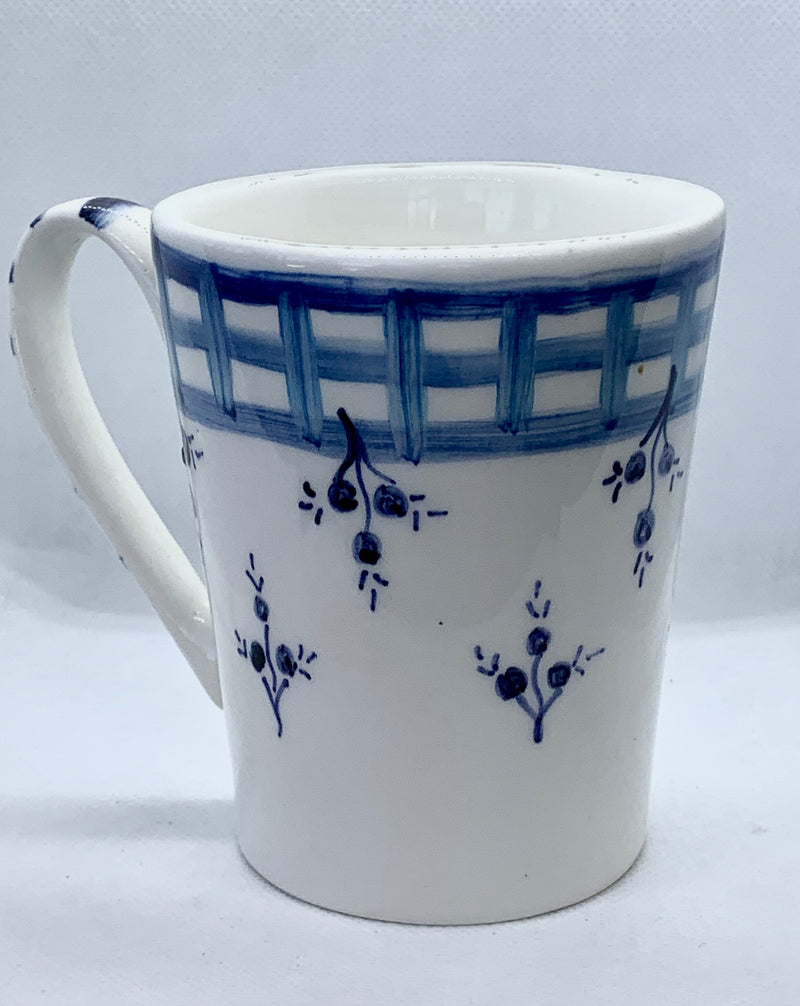 White ceramic mug with blue flowers