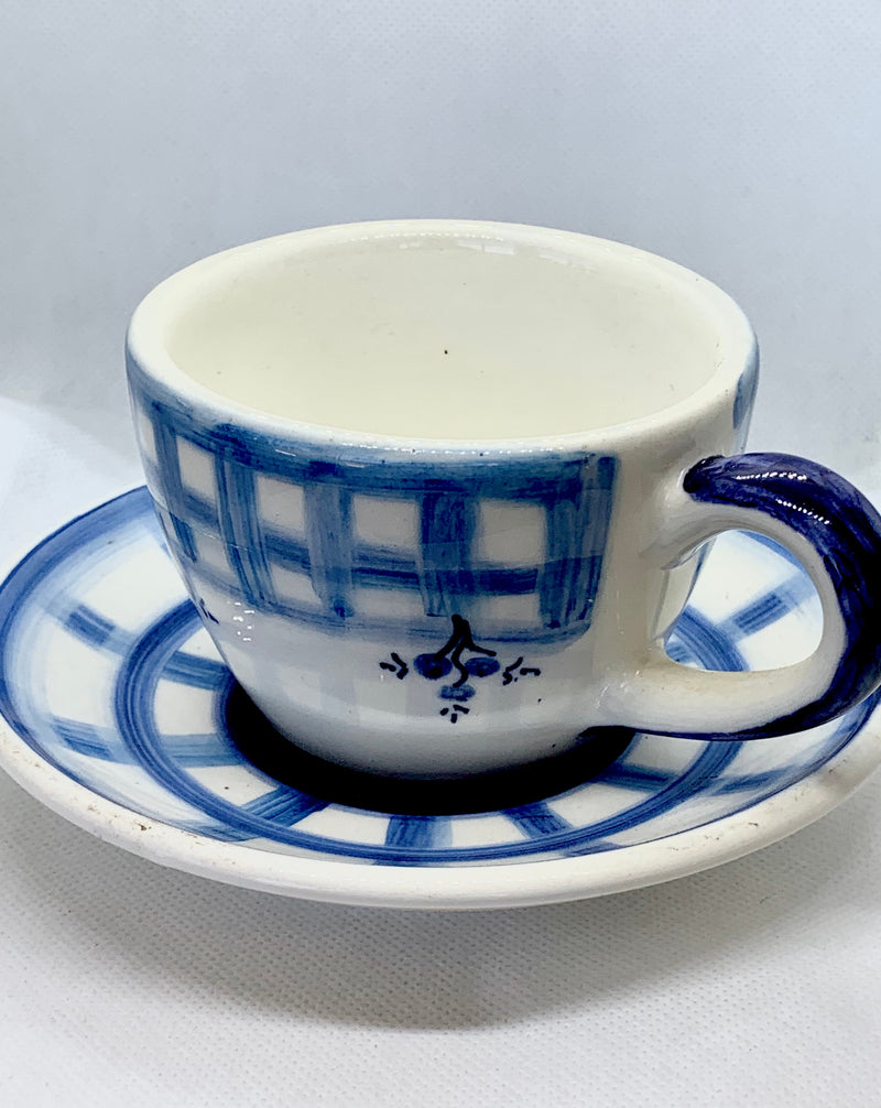 hand-painted ceramic cup in blue and white