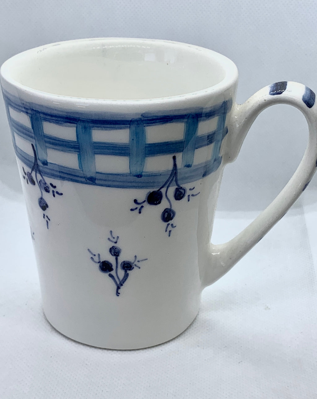 Ceramic mug with blue details