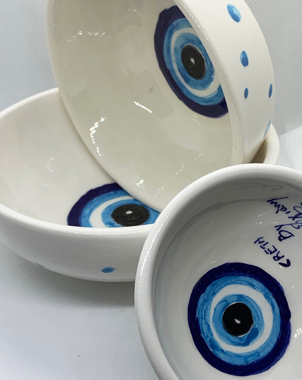 set of ceramic bowls with evil eye painted
