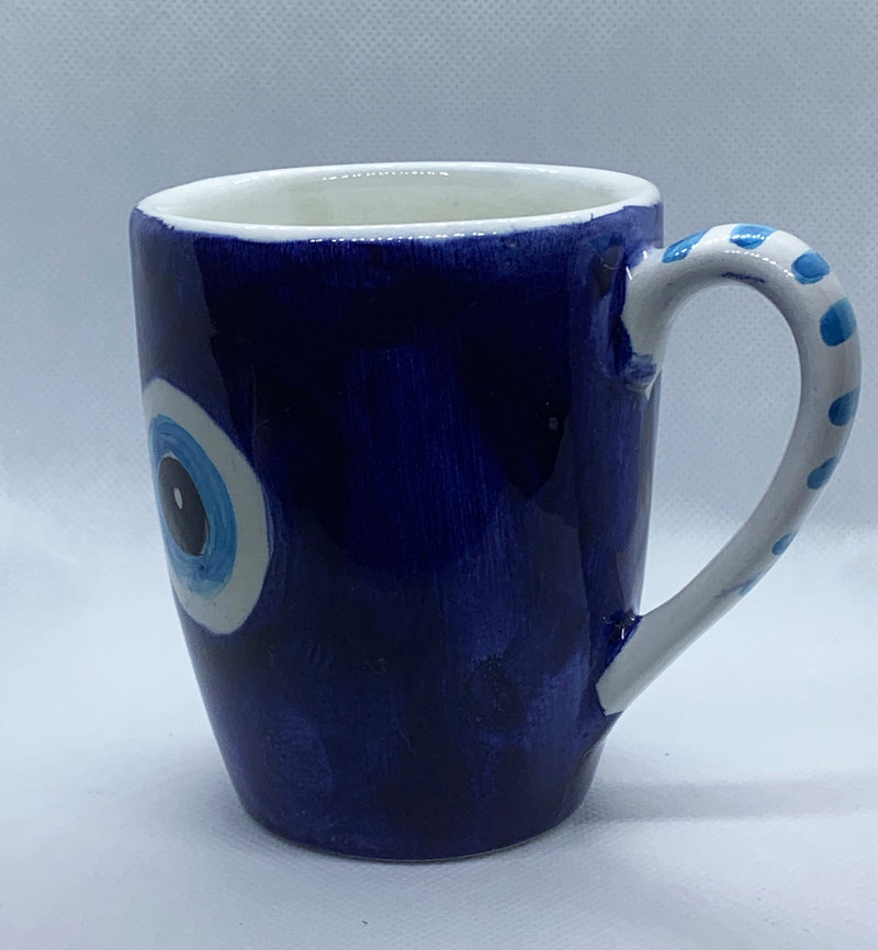blue evil eye ceramic cup with comfortable grip