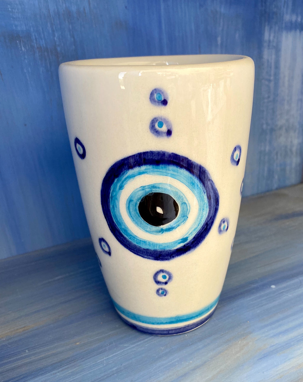 Ceramic mug with evil eye
