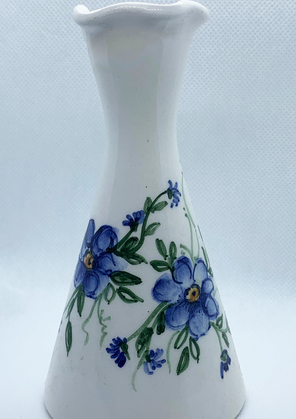 White ceramic vase with flowers