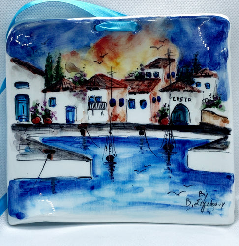 ceramic plaque, handprinted in white clay. The theme is a port in Crete, with blue shades and yellow sky