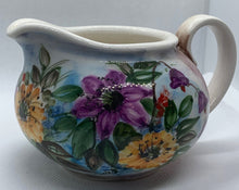 Load image into Gallery viewer, white ceramic milk jug with purple and yellow flowers and green leafs