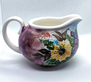 handmade ceramic milk jug with purple shades for the dinner table