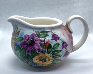 ceramic handmade and handpainted milk jug with flowers