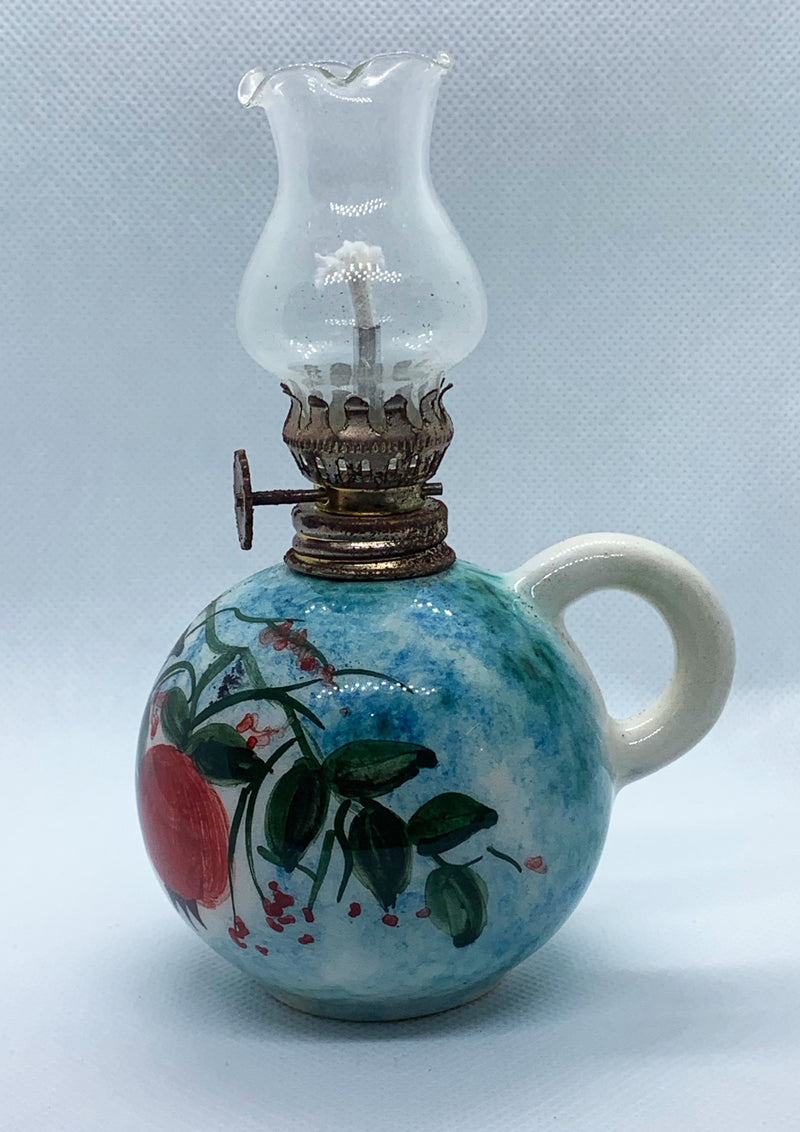 ceramic handmade and handprinted oil lamp with turquoise colours and red pomegranates