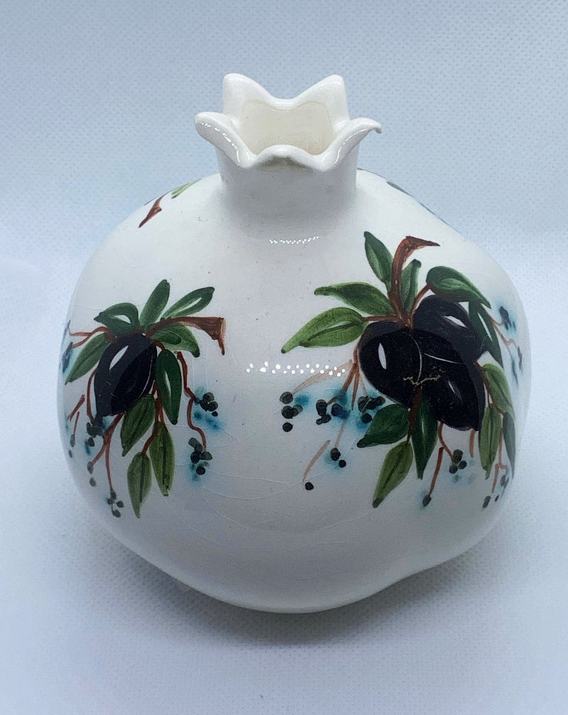 white ceramic pomegranate with olives