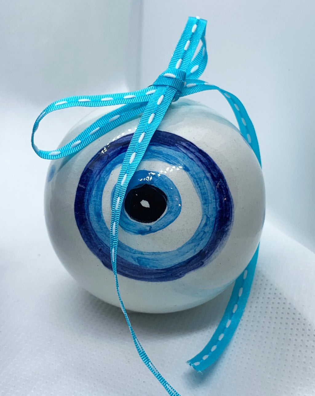 White evil eye ceramic christmas ball
