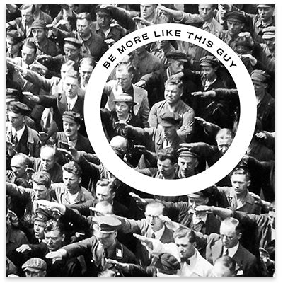 August Landmesser standing arms crossed amidst the Nazi salute.