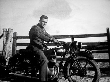 Photo of Dan's gradfather, Staff Sergeant Robert Gruber on his vintage BSA