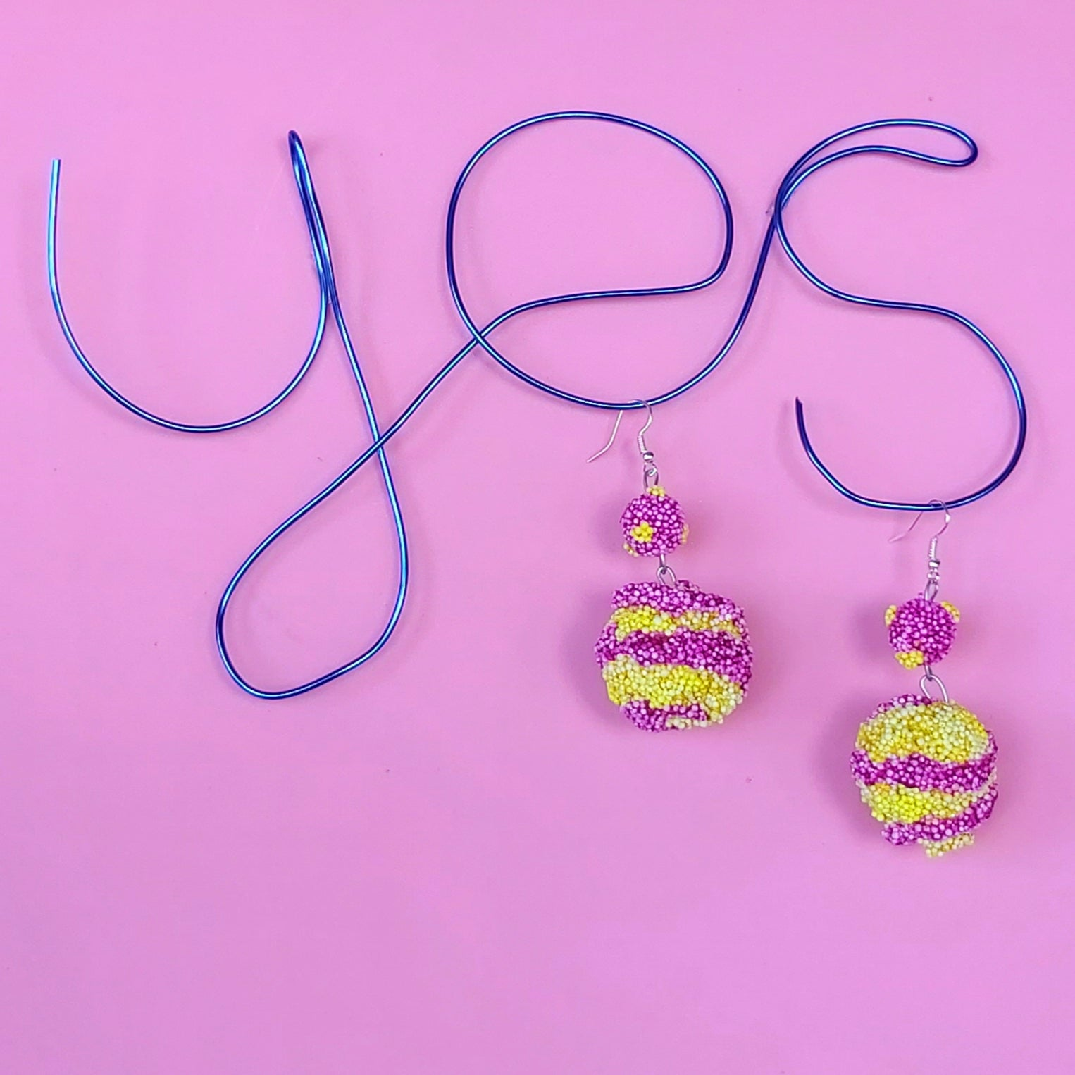 Fun, funky two tier earrings in yellow and purple stripes and polka dots. Handmade in Ireland.