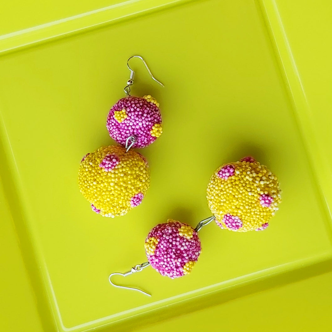 Fun colourful polka dot earrings in yellow and purple. Handcrafted in Ireland