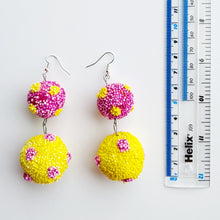 Load image into Gallery viewer, Fun colourful two tier polka dot earrings in yellow and purple.