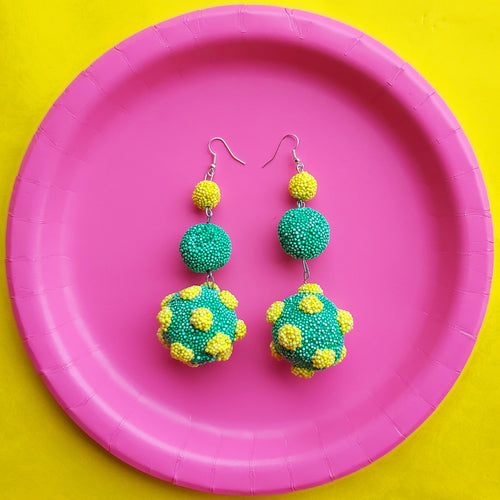 Quirky long drop statement earrings in green and yellow with polka dots. Handmade in Ireland.
