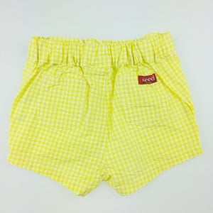 Girls Seed, yellow gingham shorts, cotton. These shorts comes in a structured style for a crisp finish. <p>With an elasticised waist and sweet gingham pattern, the bright shade is perfect for the warmer months.<p> Made from 100% cotton., NEW, size 00