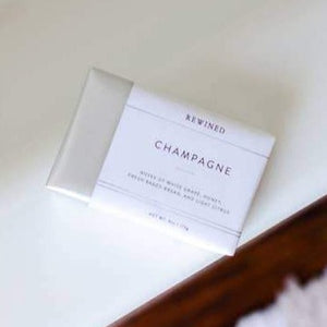 Champagne Bar soap wrapped in silver foil with white linen paper
