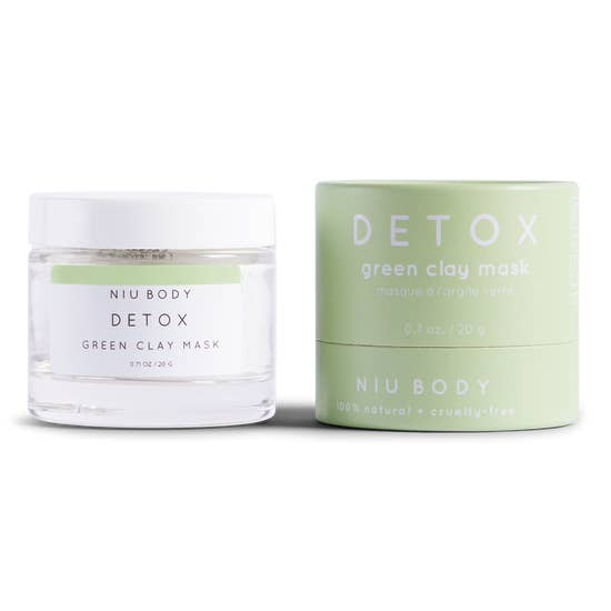 Detox green clay mask in a white jar with a mint green packaging on the side