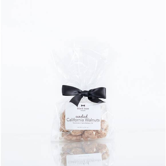 Candied walnuts in cello bag with black bow. Perfect for small giftings.