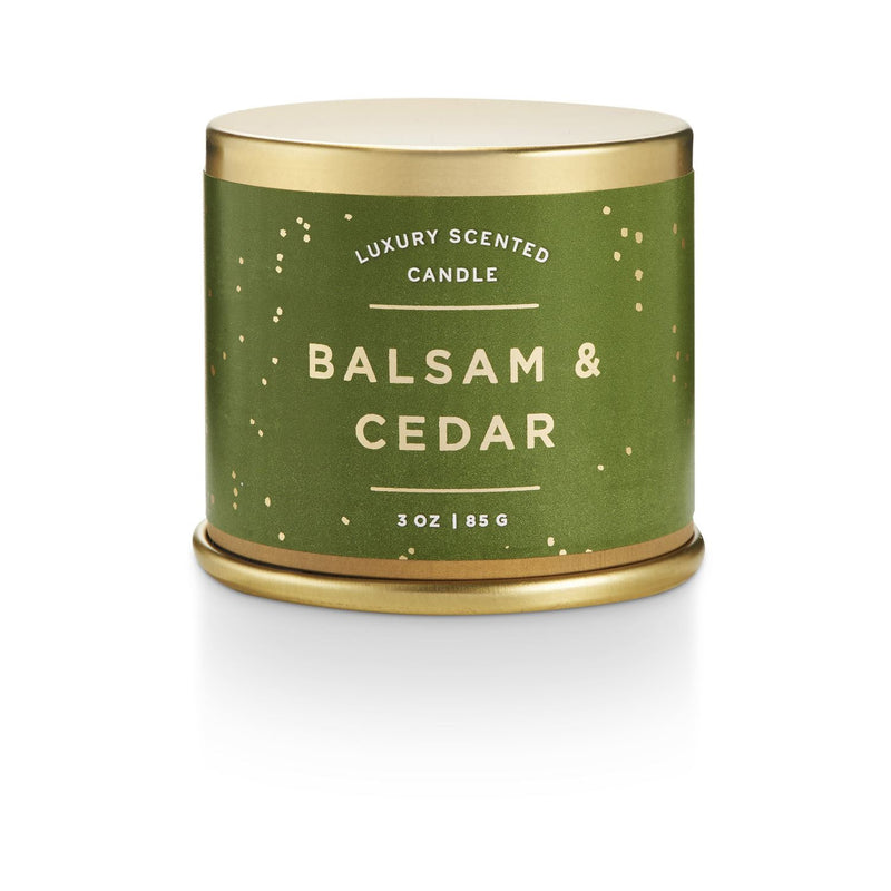 Balam Cedar demi tin candle with winter illustrations on it.