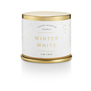 Winter white demi tin candle with winter illustrations on it.