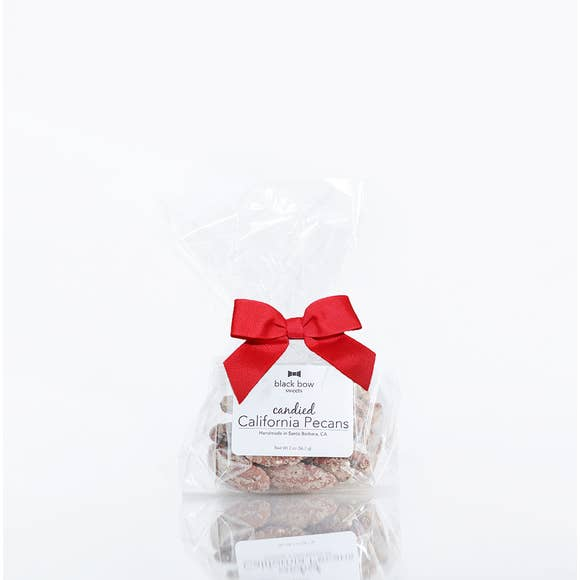 California Candied pecans in transparent cello bag with red ribbon.