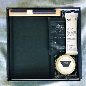 Holiday black gift box with Black vintage paper diary, paper pen, tin candle and 1 pack of coffee.