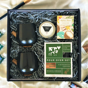 Set of 2 black ceramic mugs with Coconut vegan latte, travel candle and aromatherapy soap in black keepsake box. Perfect for holiday gifting.