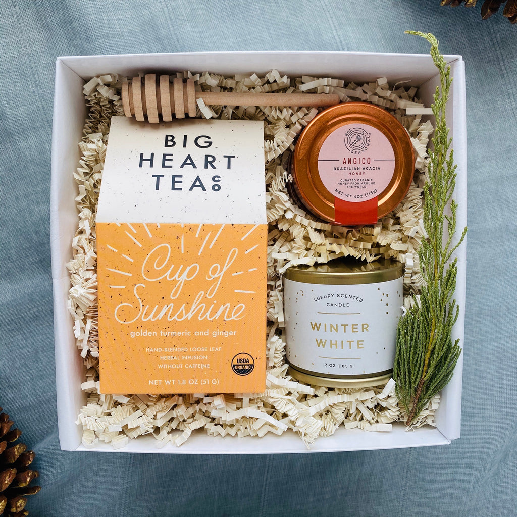 White keepsake gift box with Cup of sunshine tea, honey, winter white candle and wood dipper in it. Perfect for holiday gifts.