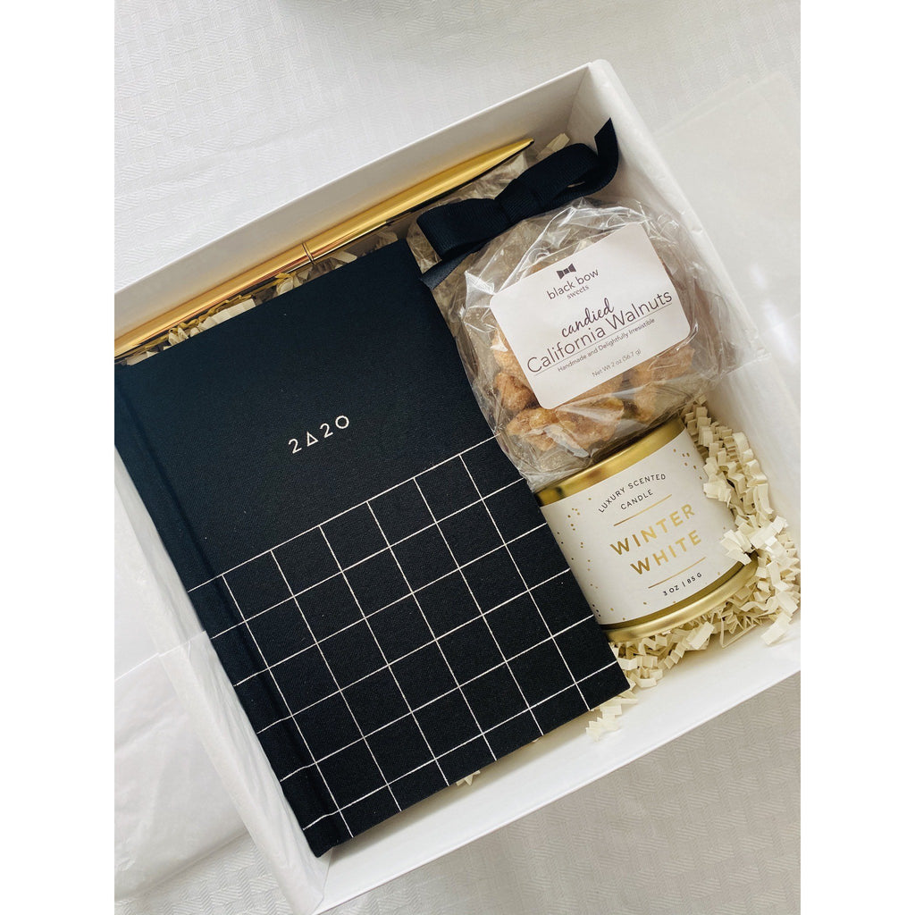 A wonderful gift for 2020. The gift box contains 2020 pocket planner, winter white candle, candied walnuts and gold slim pen just perfect for all those new year resolutions.