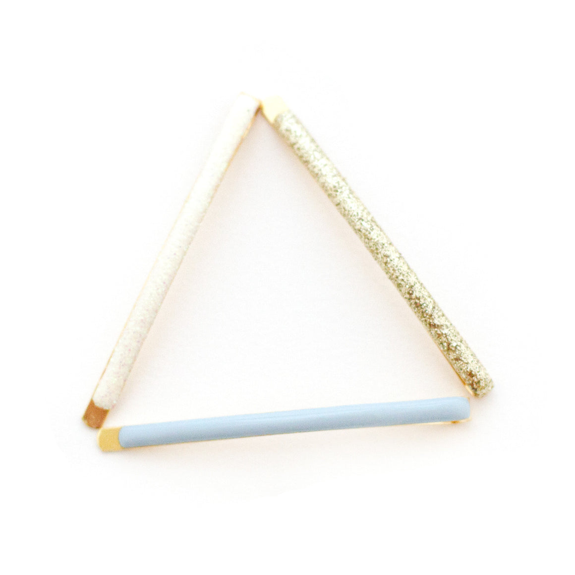 the dream date bobby pin package features gold iridescent and blue enamel glitter hair pins