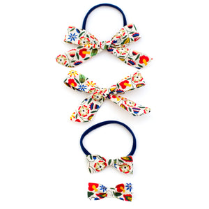 Folk Art liberty of london baby bows by mane message