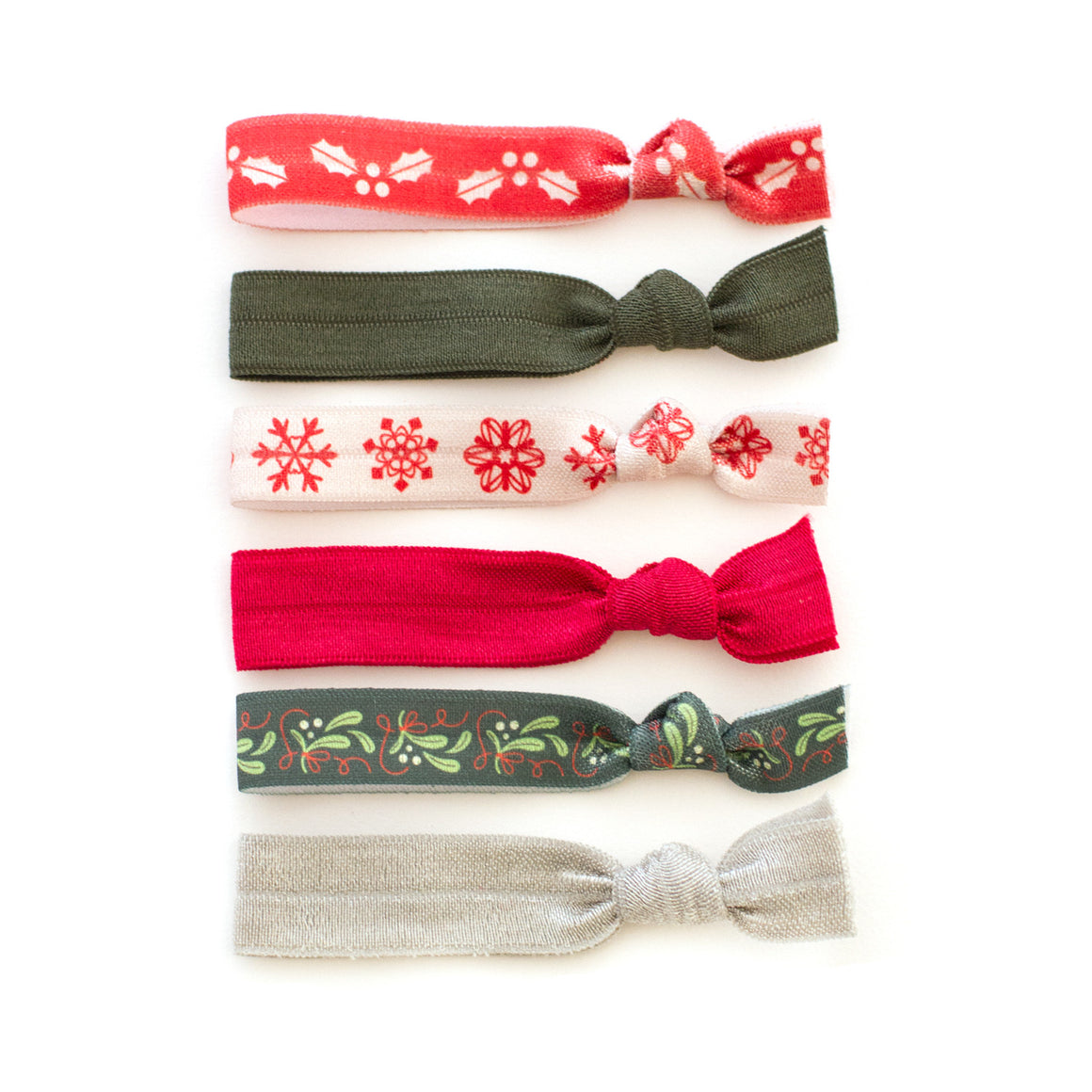 holly snowflake mistletoe christmas themed hair tie package by mane message