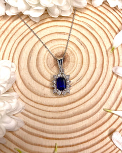9ct White Gold Pendant With Sapphire Centre Surrounded by Diamonds