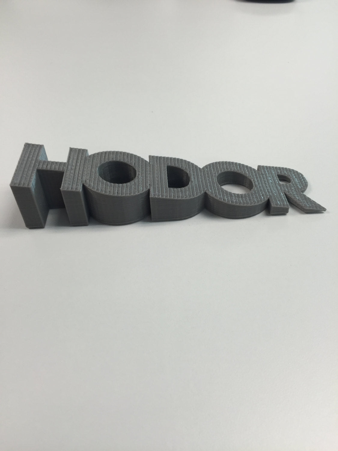 Game of Thrones inspired Hodor door stop! Memorialize Hodor's greatest sacrifice in style! 3D printed plastic door stop