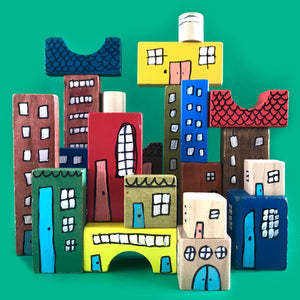 Wooden building blocks decorated to make buildings