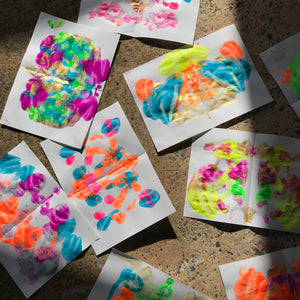 Squashed paint butterflies kids process art