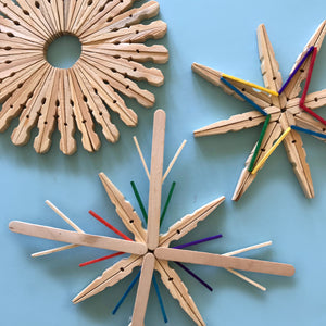 Pretty wooden Christmas snowflakes made from clothes pegs
