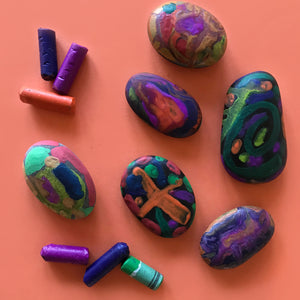 Decorated rocks using melted wax crayons