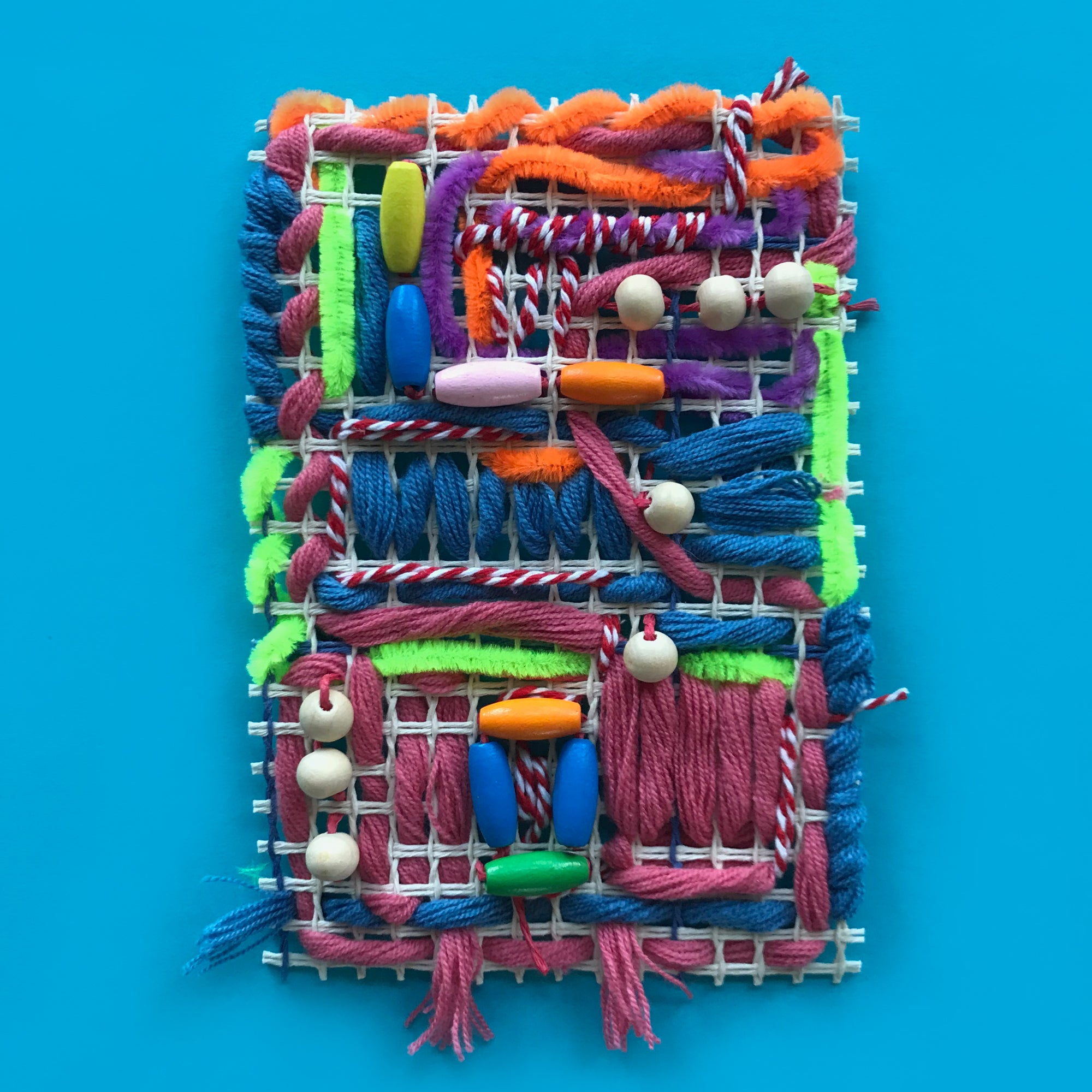 Mixed media textile weaving for kids