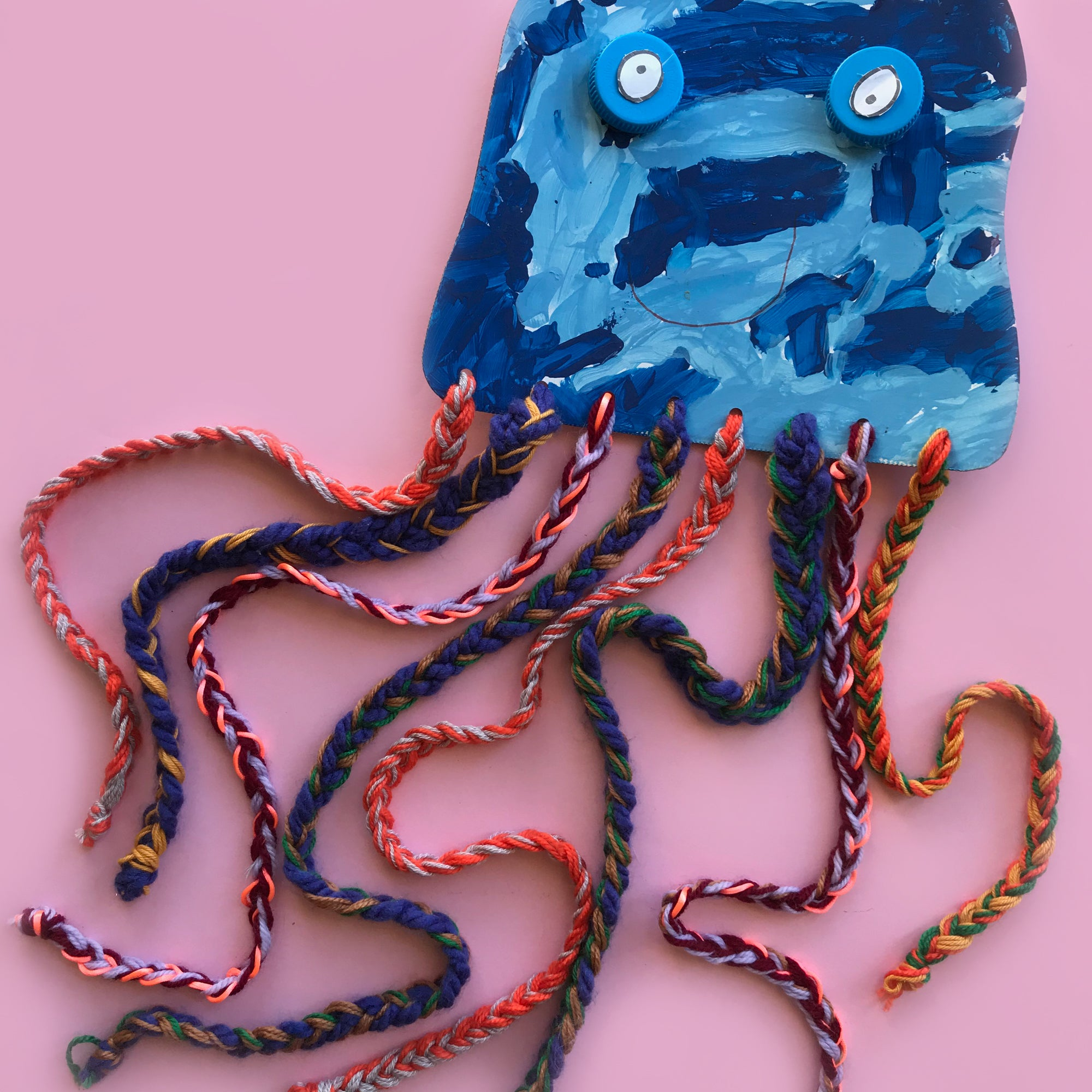 Painted jelly fish with paited yarn tentacles kids craft