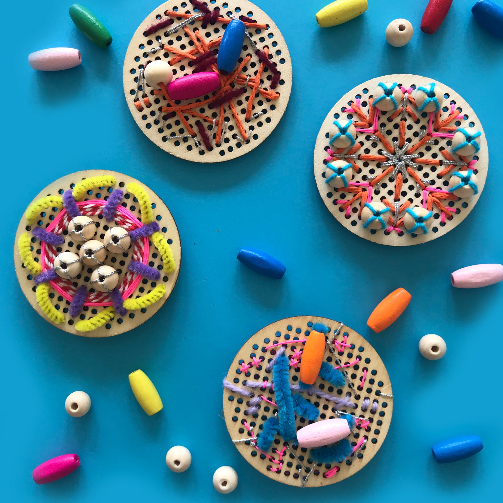 Kids embroidery onto wooden discs