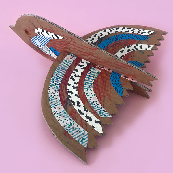 cardboard bird craft with collage paper decorations