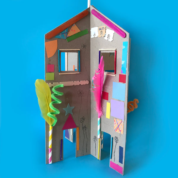 simple 3D cardboard house decorated with colourful collage