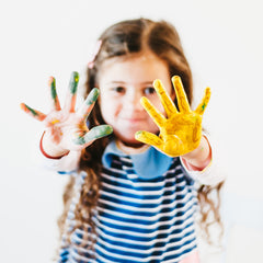 Kids with paint covered hands