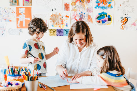 Eleanor Ford making art with her children
