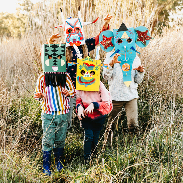 Animal and monster masks made from cardboard boxes