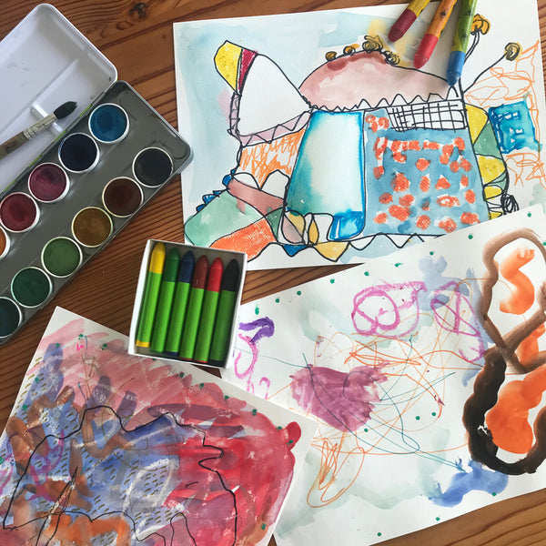 Kids art with natural water colour paints and wax crayons
