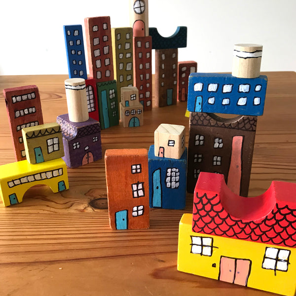 Wooden building blocks decorated to make city buildings